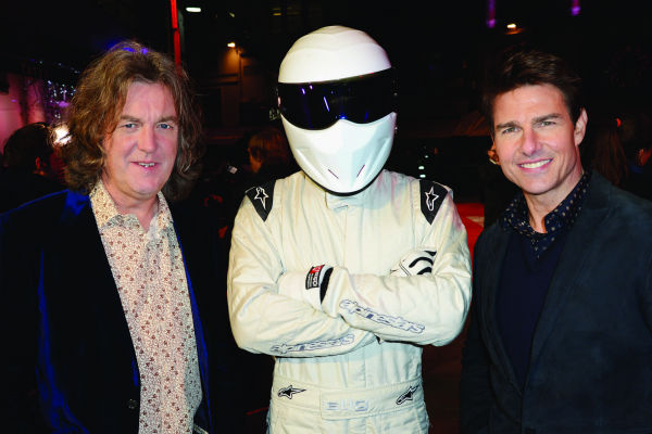 (L-R) James May, The Stig and Tom Cruise attend the world premiere of 'Jack Reacher' at The Odeon Leicester Square in London on Dec. 10, 2012.
