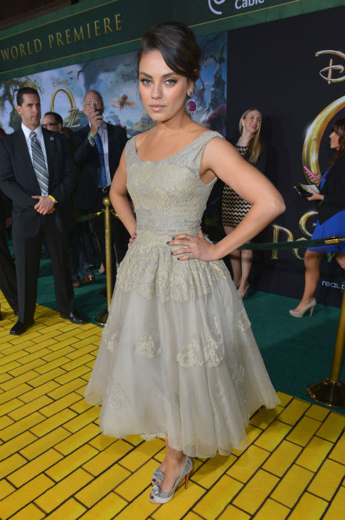 Mila Kunis attends Walt Disney Pictures&#39; world premiere of &#39;Oz The Great And Powerful&#39; at the El Capitan Theatre in Hollywood, California on February 13, 2013. She is wearing an embroidered gray Dolce and Gabbana frock and silver Christian Louboutin peeptoe pumps <span class=meta>(Alberto E. Rodriguez &#47; WireImage)</span>