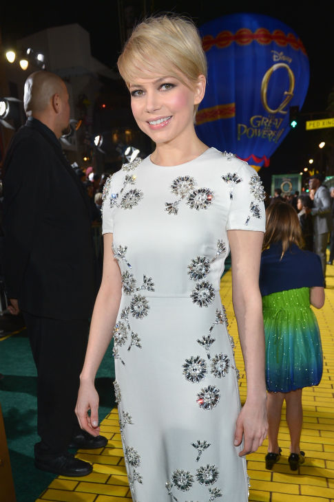 Michelle Williams attends Walt Disney Pictures&#39; world premiere of &#39;Oz The Great And Powerful&#39; at the El Capitan Theatre in Hollywood, California on February 13, 2013. She is wearing a white, short-sleeved Prada dress with a sparkling flower design and black Prada T-bar sandals with Swarovski crystals. <span class=meta>(Alberto E. Rodriguez &#47; WireImage)</span>