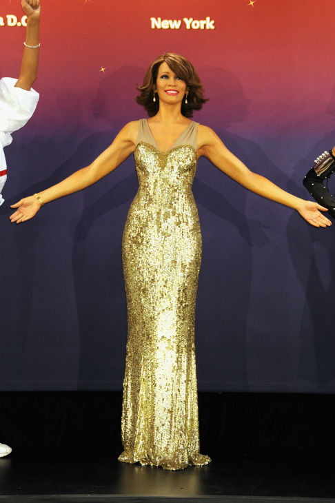 Madame Tussauds unveiled four wax figures of late singer Whitney Houston in New York on Feb. 7, 2013, almost one year after her death. This one on the left depicts her in a gow
