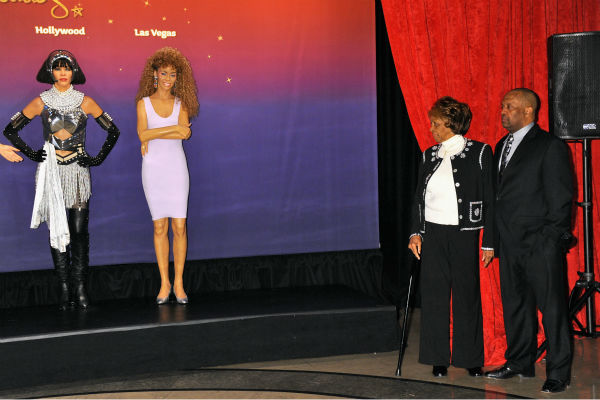 Cissy Houston (left) and son Gary attend Madame Tussauds' unveiling of  four wax figures of the late Whitney Houston on Feb. 7, 2013 in New York City.