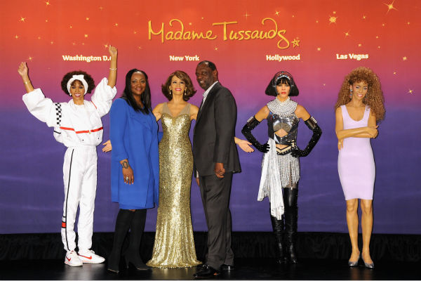 Gary Houston, brother of Whitney Houston, and wife Pat pose next to  one of four Madame Tussauds wax figures of the late singer that were unveiled on Feb. 7, 2013 in New York City.
