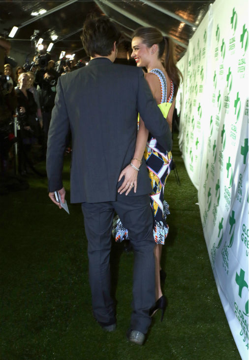 Victoria&#39;s Secret supermodel Miranda Kerr puts her hand playfully on husband and actor Orlando Bloom at Global Green USA&#39;s 10th annual Pre-Oscars Party at the Avalon club in Hollywood, California on Feb. 20, 2013. &#40;Watch a video of the two at the party.&#41; <span class=meta>(Alexandra Wyman &#47; Getty Images for Global Green)</span>