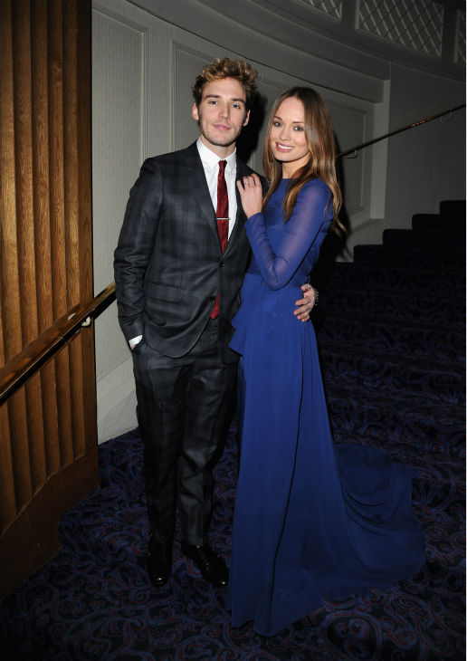 "<div class=""meta ""><span class=""caption-text "">Sam Claflin and Laura Haddock pose at the Jameson Empire Awards at Grosvenor House on March 24, 2013 in London, England. Renowned for being one of the most laid-back awards shows in the British movie calendar, the Jameson Empire Awards are chosen by readers of Empire Magazine, who vote for their favorites. (Jameson via Getty Images)</span></div>"