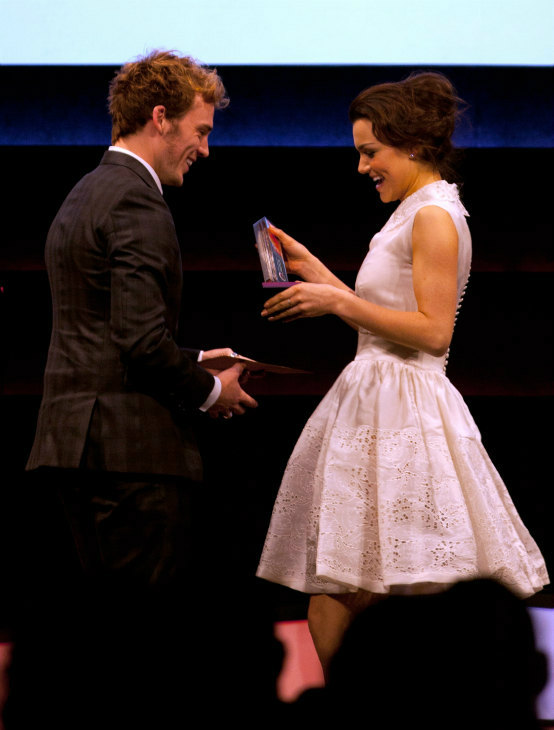 "<div class=""meta ""><span class=""caption-text "">Actress Samantha Barks receives the Best Female Newcomer award from award presenter Sam Claflin during the Jameson Empire Awards at Grosvenor House on March 24, 2013 in London, England. Renowned for being one of the most laid-back awards shows in the British movie calendar, the Jameson Empire Awards are chosen by readers of Empire Magazine, who vote for their favorites. (Jameson via Getty Images)</span></div>"