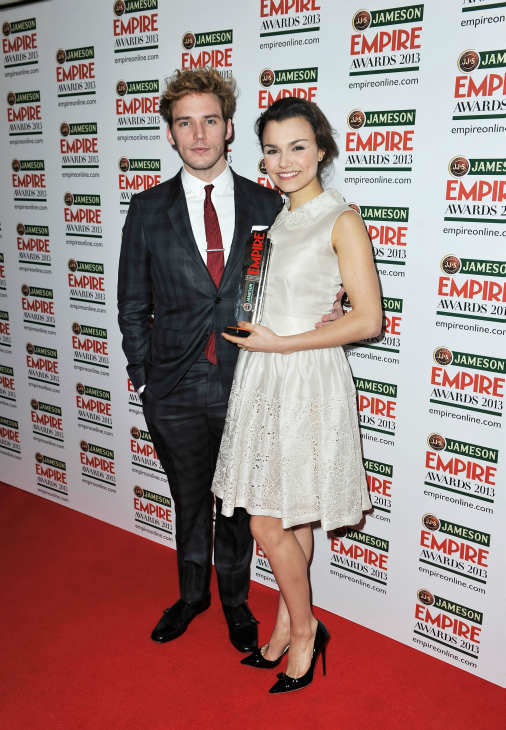Actress Samantha Barks poses with the Best Female Newcomer award and Sam Claflin at the Jameson Empire Awards at Grosvenor House on March 24, 2013 in London, England. Renowned for being one of the most laid-back awards shows in the British movie calendar, the Jameson Empire Awards are chosen by readers of Empire Magazine, who vote for their favorites. <span class=meta>(Jameson via Getty Images)</span>