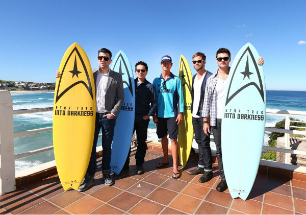 "<div class=""meta ""><span class=""caption-text "">Zachary Quinto (Spock), director J.J. Abrams, Lifeguard Dean 'Deano' Gladstone, Chris Pine (Kirk) and Karl Urban (Bones) pose at Bondi Beach at the 'Star Trek Into Darkness' photo call on April 22, 2013 in Sydney, Australia.  (Marianna Massey / Getty Images for Paramount Pictures International)</span></div>"
