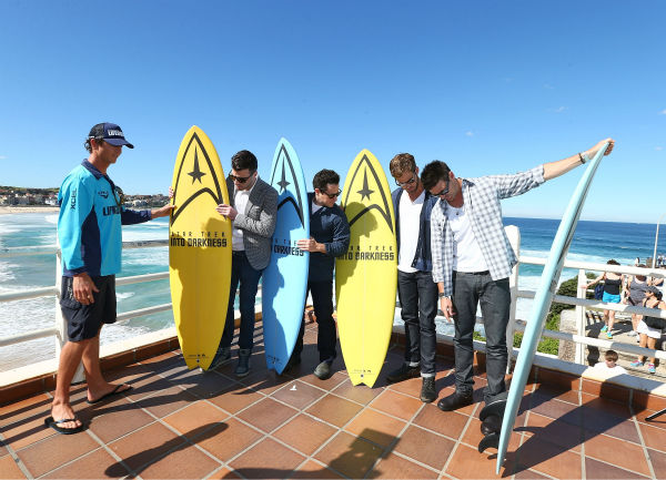 "<div class=""meta image-caption""><div class=""origin-logo origin-image ""><span></span></div><span class=""caption-text"">Lifeguard Dean 'Deano' Gladstone presents surfboards to Zachary Quinto (Spock), director J.J. Abrams, Chris Pine (Kirk) and Karl Urban (Bones  at Bondi Beach at the 'Star Trek Into Darkness' photo call on April 22, 2013 in Sydney, Australia. (Marianna Massey / Getty Images for Paramount Pictures International)</span></div>"