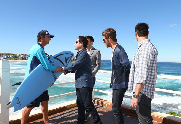 Lifeguard Dean &#39;Deano&#39; Gladstone presents surfboards to Zachary Quinto &#40;Spock&#41;, director J.J. Abrams, Chris Pine &#40;Kirk&#41; and Karl Urban &#40;Bones  at Bondi Beach at the &#39;Star Trek Into Darkness&#39; photo call on April 22, 2013 in Sydney, Australia. <span class=meta>(Marianna Massey &#47; Getty Images for Paramount Pictures International)</span>