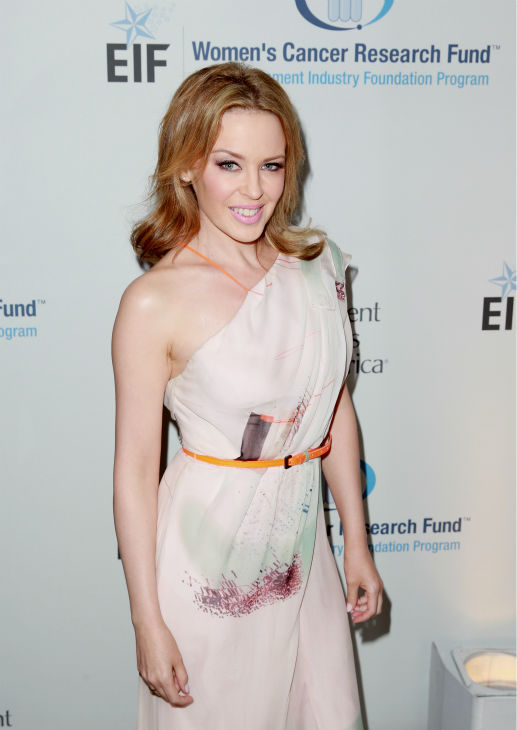 Kylie Minogue, wearing a Carolina Herrera gown, appears at the EIF Womens Cancer Research Fund&#39;s 16th Annual &#39;An Unforgettable Evening&#39; event, presented by Saks Fifth Avenue, at the Beverly Wilshire Four Seasons Hotel on May 2, 2013 in Beverly Hills, California. The Australian pop singer and breast cancer survivor received the Courage Award. <span class=meta>(Joe Scarnici &#47; Getty Images for EIF)</span>