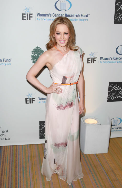 "<div class=""meta image-caption""><div class=""origin-logo origin-image ""><span></span></div><span class=""caption-text"">Kylie Minogue, wearing a Carolina Herrera gown, appears at the EIF Womens Cancer Research Fund's 16th Annual 'An Unforgettable Evening' event, presented by Saks Fifth Avenue, at the Beverly Wilshire Four Seasons Hotel on May 2, 2013 in Beverly Hills, California. The Australian pop singer and breast cancer survivor received the Courage Award. (Joe Scarnici / Getty Images for EIF)</span></div>"