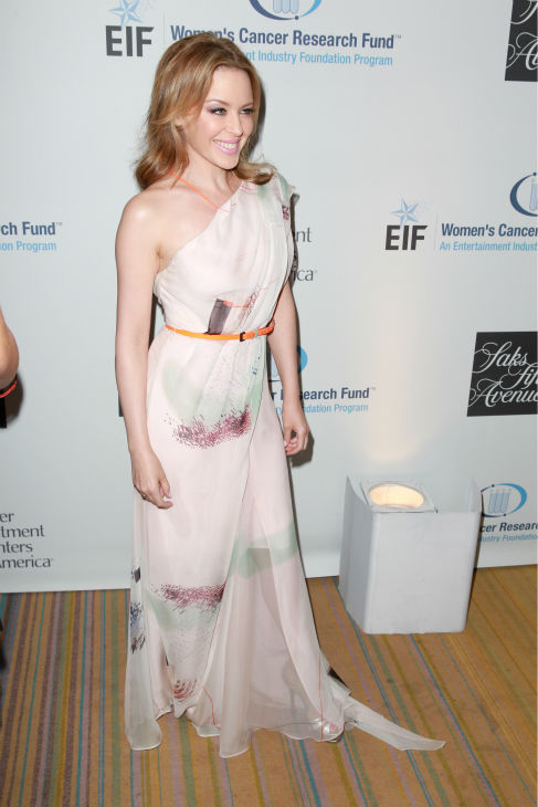 "<div class=""meta ""><span class=""caption-text "">Kylie Minogue, wearing a Carolina Herrera gown, appears at the EIF Womens Cancer Research Fund's 16th Annual 'An Unforgettable Evening' event, presented by Saks Fifth Avenue, at the Beverly Wilshire Four Seasons Hotel on May 2, 2013 in Beverly Hills, California. The Australian pop singer and breast cancer survivor received the Courage Award. (Joe Scarnici / Getty Images for EIF)</span></div>"