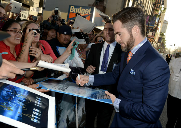 "<div class=""meta image-caption""><div class=""origin-logo origin-image ""><span></span></div><span class=""caption-text"">Chris Pine signs autographs at the premiere of Paramount Pictures' 'Star Trek Into Darkness' at the Dolby Theatre in Hollywood, California on May 14, 2013.  (Kevin Winter / Getty Images for Paramount Pictures)</span></div>"