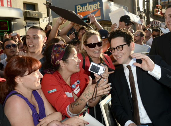 "<div class=""meta image-caption""><div class=""origin-logo origin-image ""><span></span></div><span class=""caption-text"">Director/producer J.J. Abrams poses with fans as he arrives at the premiere of Paramount Pictures' 'Star Trek Into Darkness' at the Dolby Theatre in Hollywood, California on May 14, 2013.  (Kevin Winter / Getty Images for Paramount Pictures)</span></div>"