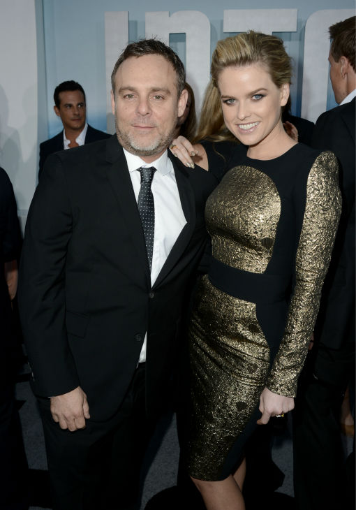 Producer Bryan Burk &#40;L&#41; and actress Alice Eve &#40;Carol&#41; attend the premiere of Paramount Pictures&#39; &#39;Star Trek Into Darkness&#39; at the Dolby Theatre in Hollywood, California on May 14, 2013. She is wearing a black and gold Zuhair Murad Pre-Fall 2013 dress and black, strappy Giuseppe Zanotti sandals. <span class=meta>(Kevin Winter &#47; Getty Images for Paramount Pictures)</span>