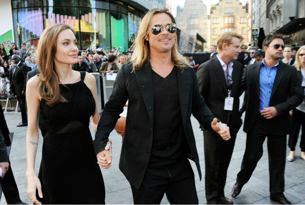 "<div class=""meta ""><span class=""caption-text "">Cast member Brad Pitt and fiancee Angelina Jolie attend the world premiere of 'World War Z' at the Empire Cinema Leicester Square in London on June 2, 2013. It marked her first public appearance since revealing in May that she had undergone a double mastectomy. (Dave M. Benett / WireImage for Paramount)</span></div>"