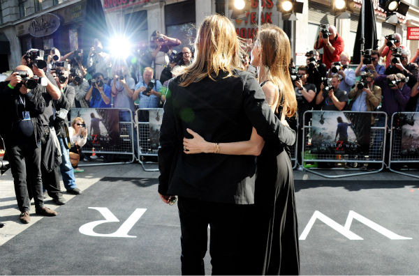 Cast member Brad Pitt and fiancee Angelina Jolie attend the world premiere of 'World War Z' at the Empire Cinema Leicester Square in London on June 2, 2013.