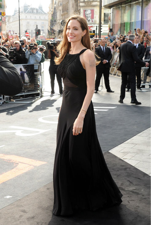 "<div class=""meta image-caption""><div class=""origin-logo origin-image ""><span></span></div><span class=""caption-text"">Angelina Jolie attends the world premiere of 'World War Z,' which stars fiance Brad Pitt, at the Empire Cinema Leicester Square in London on June 2, 2013. It marked her first public appearance since revealing in May that she had undergone a double mastectomy. (Dave M. Benett / WireImage for Paramount)</span></div>"