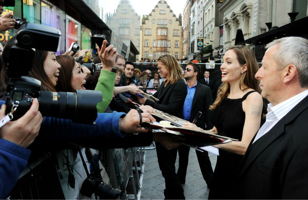 "<div class=""meta image-caption""><div class=""origin-logo origin-image ""><span></span></div><span class=""caption-text"">Angelina Jolie signs autographs for fans at the world premiere of 'World War Z,' which stars fiance Brad Pitt, at the Empire Cinema Leicester Square in London on June 2, 2013. It marked her first public appearance since revealing in May that she had undergone a double mastectomy. (Dave M. Benett / WireImage for Paramount)</span></div>"