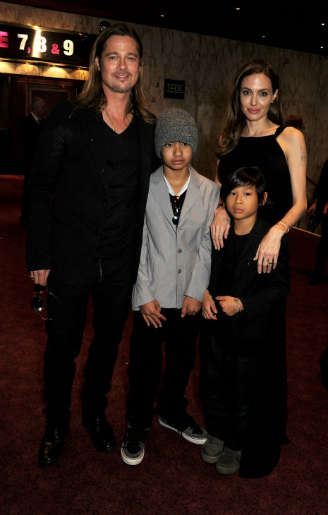 "<div class=""meta image-caption""><div class=""origin-logo origin-image ""><span></span></div><span class=""caption-text"">Cast member Brad Pitt, fiancee Angelina Jolie and sons Maddox and Pax, two of their six children, attends the world premiere of 'World War Z' at the Empire Cinema Leicester Square in London on June 2, 2013. (Dave M. Benett / WireImage for Paramount)</span></div>"
