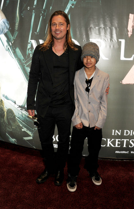Cast member Brad Pitt and son Maddox, one of his and Angelina Jolie&#39;s six children, attend the world premiere of &#39;World War Z&#39; at the Empire Cinema Leicester Square in London on June 2, 2013. <span class=meta>(Dave M. Benett &#47; WireImage for Paramount)</span>