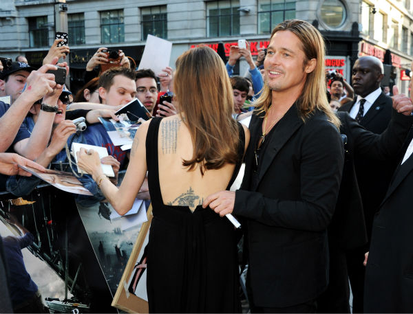 Cast member Brad Pitt and fiancee Angelina Jolie attend the world premiere of &#39;World War Z&#39; at the Empire Cinema Leicester Square in London on June 2, 2013. <span class=meta>(Dave M. Benett &#47; WireImage for Paramount)</span>