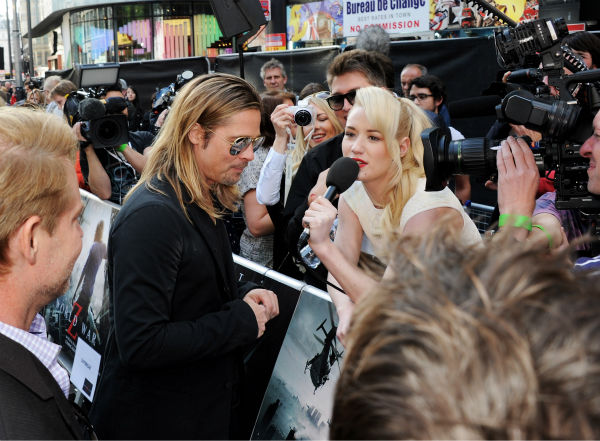 Cast member Brad Pitt signs autographs for fans at the world premiere of &#39;World War Z&#39; at the Empire Cinema Leicester Square in London on June 2, 2013. <span class=meta>(Dave M. Benett &#47; WireImage for Paramount)</span>