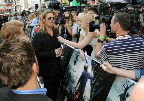 "<div class=""meta ""><span class=""caption-text "">Cast member Brad Pitt signs autographs for fans at the world premiere of 'World War Z' at the Empire Cinema Leicester Square in London on June 2, 2013. (Dave M. Benett / WireImage for Paramount)</span></div>"