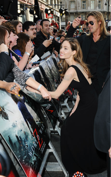 "<div class=""meta image-caption""><div class=""origin-logo origin-image ""><span></span></div><span class=""caption-text"">Cast member Brad Pitt and fiancee Angelina Jolie attend the world premiere of 'World War Z' at the Empire Cinema Leicester Square in London on June 2, 2013. (Stuart C. Wilson / Getty Images for Paramount Pictures International)</span></div>"