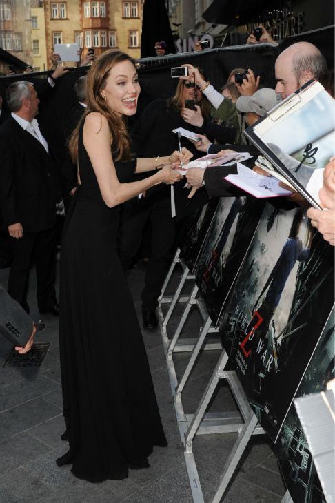 Angelina Jolie signs autographs for fans at the world premiere of &#39;World War Z,&#39; which stars fiance Brad Pitt, at the Empire Cinema Leicester Square in London on June 2, 2013. It marked her first public appearance since revealing in May that she had undergone a double mastectomy. <span class=meta>(Stuart C. Wilson &#47; Getty Images for Paramount Pictures International)</span>