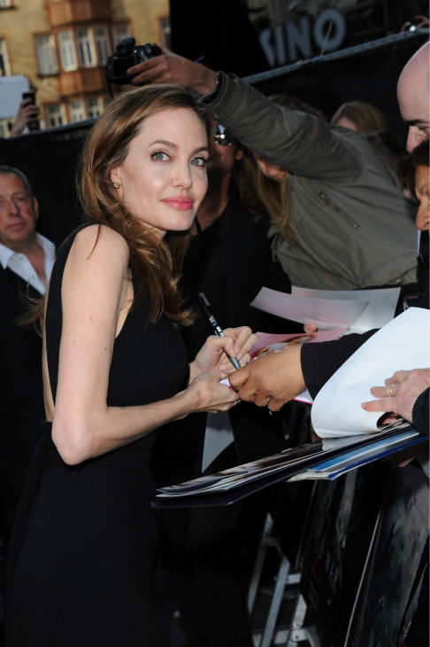 Angelina Jolie signs autographs for fans at the world premiere of &#39;World War Z,&#39; which stars fiance Brad Pitt, at the Empire Cinema Leicester Square in London on June 2, 2013. <span class=meta>(Stuart C. Wilson &#47; Getty Images for Paramount Pictures International)</span>