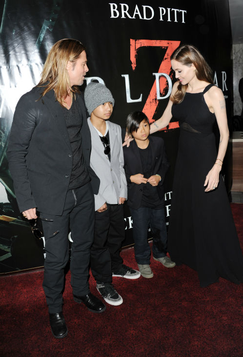 Cast member Brad Pitt, fiancee Angelina Jolie and sons Maddox and Pax, two of their six children, attends the world premiere of 'World War Z' at the Empire Cinema Leicester Square in London on June 2, 2013.