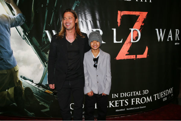 Cast member Brad Pitt and his and fiancee Angelina Jolie&#39;s son Maddox, one of their six children, attend the world premiere of &#39;World War Z&#39; at the Empire Cinema Leicester Square in London on June 2, 2013. <span class=meta>(Lucian Capellaro &#47; WireImage for Paramount)</span>