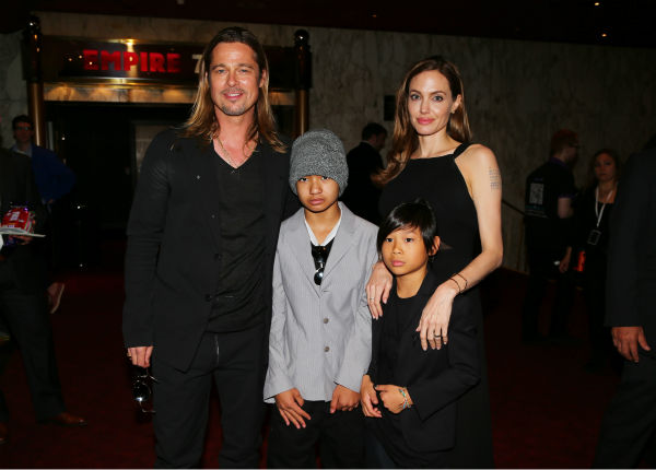 Cast member Brad Pitt, fiancee Angelina Jolie and sons Maddox and Pax, two of their six children, attends the world premiere of &#39;World War Z&#39; at the Empire Cinema Leicester Square in London on June 2, 2013. <span class=meta>(Lucian Capellaro &#47; WireImage for Paramount)</span>