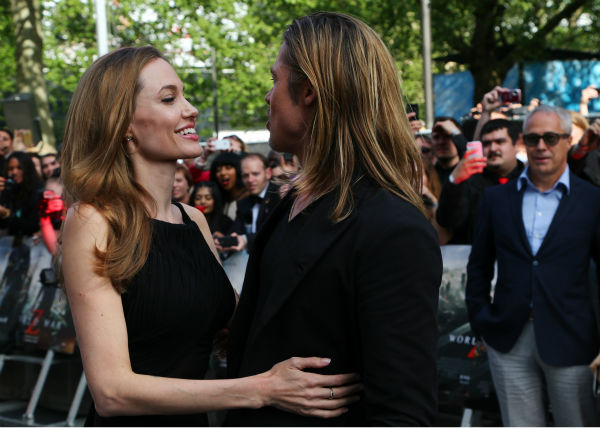 Cast member Brad Pitt and fiancee Angelina Jolie attend the world premiere of &#39;World War Z&#39; at the Empire Cinema Leicester Square in London on June 2, 2013. It marked her first public appearance since revealing in May that she had undergone a double mastectomy. <span class=meta>(Lucian Capellaro &#47; WireImage for Paramount)</span>