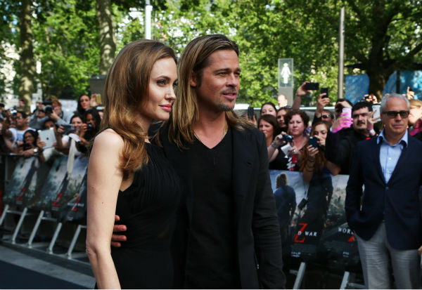Cast member Brad Pitt and fiancee Angelina Jolie attend the world premiere of &#39;World War Z&#39; at the Empire Cinema Leicester Square in London on June 2, 2013. <span class=meta>(Lucian Capellaro &#47; Getty Images for Paramount Pictures International)</span>