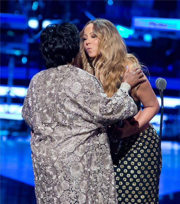 Mariah Carey embraces Patti LaBelle before presenting her with the Living Legend Award at BET's 2013 Blac
