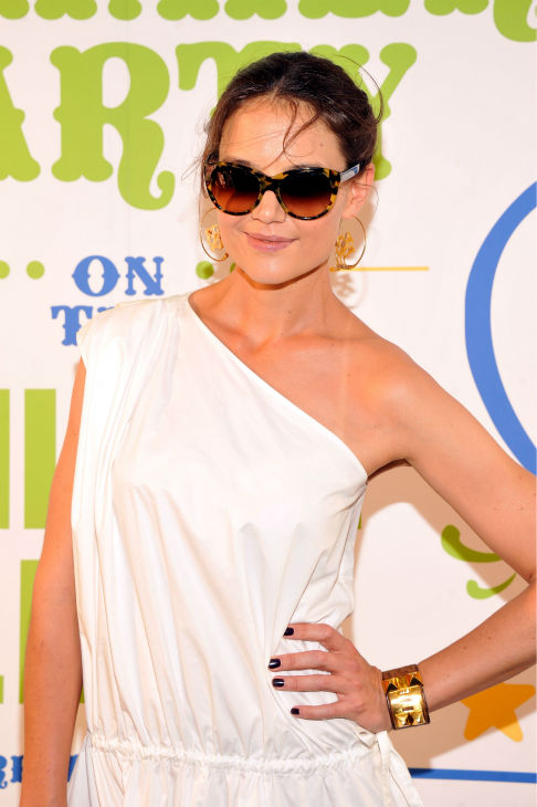 Katie Holmes attends Summer Party on The Highline, presented by Coach at High Line Park in New York City on June 11, 2013. She is wearing a white one-shoulder Chloe Resort 2013 dress, paried with a Coach &#39;Madison&#39; clutch and Azzedine Ala?a gladiator sandals. <span class=meta>(Stephen Lovekin &#47; Getty Images for COACH)</span>