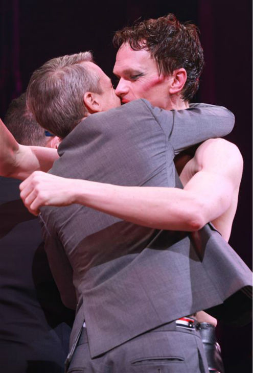 Neil Patrick Harris kisses writer John Cameron Mitchell on stage during opening night of the rock musical &#39;Hedwig and the Angry Itch&#39; on Broadway in New York on April 22, 2014. The &#39;How I Met Your Mother&#39; and &#39;Doogie Howser&#39; alum plays a transgender East German rocker in the show, which is set during the Cold War. Hedwig lives in a trailer park in Kansas and is the singer of a band called the Angry Itch. She longs to be reunited with her lover, Tommy. <span class=meta>(Adam Nemser &#47; Startraksphoto.com)</span>