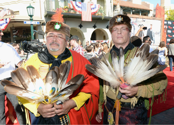 "<div class=""meta ""><span class=""caption-text "">Two unidentified guests attend the world premiere of Disney/Jerry Bruckheimer Films' 'The Lone Ranger' at Disney California Adventure Park in Disneyland in Anaheim, California on June 22, 2013. (Michael Buckner / WireImage / Walt Disney Company)</span></div>"