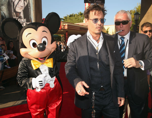 Cast member Johnny Depp and Mickey Mouse attend the world premiere of Disney/Jerry Bruckheimer Films' 'The Lone Ranger' at Disney California Adventure Park in Disneyland in Anaheim, California on June 22, 2013.