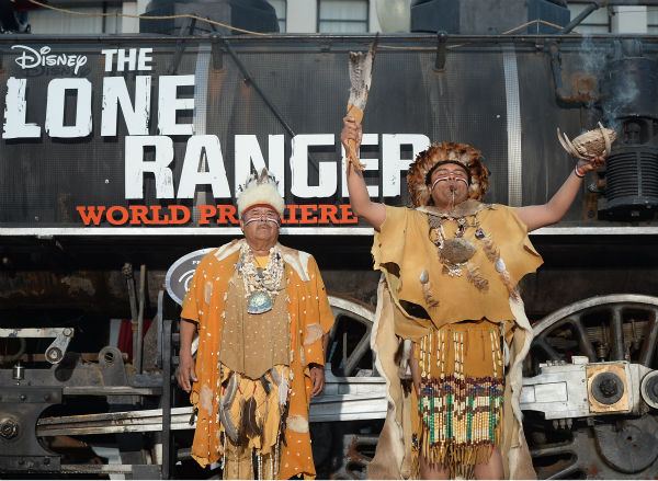 "<div class=""meta image-caption""><div class=""origin-logo origin-image ""><span></span></div><span class=""caption-text"">Two unidentified people dressed as Native American warriors attend the world premiere of Disney/Jerry Bruckheimer Films' 'The Lone Ranger' at Disney California Adventure Park in Disneyland in Anaheim, California on June 22, 2013. (Michael Buckner / WireImage / Walt Disney Company)</span></div>"