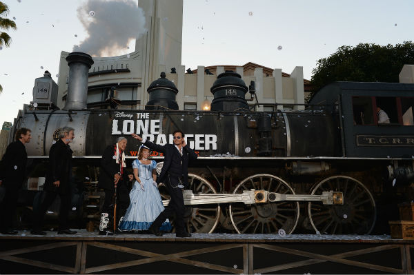 "<div class=""meta ""><span class=""caption-text "">Producer Jerry Bruckheimer, director Gore Verbinski and cast members Saginaw Grant and Johnny Depp attend the world premiere of Disney/Jerry Bruckheimer Films' 'The Lone Ranger' at Disney California Adventure Park in Disneyland in Anaheim, California on June 22, 2013. (Michael Buckner / WireImage / Walt Disney Company)</span></div>"