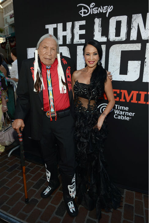 Cast member Saginaw Grant &#40;L&#41; and a guest attend the world premiere of Disney&#47;Jerry Bruckheimer Films&#39; &#39;The Lone Ranger&#39; at Disney California Adventure Park in Disneyland in Anaheim, California on June 22, 2013. <span class=meta>(Michael Buckner &#47; WireImage &#47; Walt Disney Company)</span>