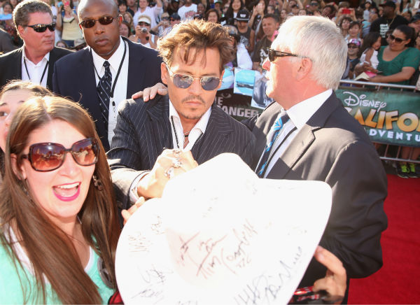 "<div class=""meta ""><span class=""caption-text "">Cast member Johnny Depp attends the world premiere of Disney/Jerry Bruckheimer Films' 'The Lone Ranger' at Disney California Adventure Park in Disneyland in Anaheim, California on June 22, 2013. (Christopher Polk / WireImage / Walt Disney Company)</span></div>"