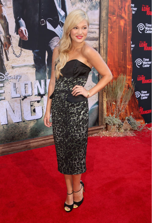 "<div class=""meta image-caption""><div class=""origin-logo origin-image ""><span></span></div><span class=""caption-text"">Olivia Holt of the Disney Channel series 'Kickin' It' attends the world premiere of Disney/Jerry Bruckheimer Films' 'The Lone Ranger' at Disney California Adventure Park in Disneyland in Anaheim, California on June 22, 2013. (Christopher Polk / WireImage / Walt Disney Company)</span></div>"