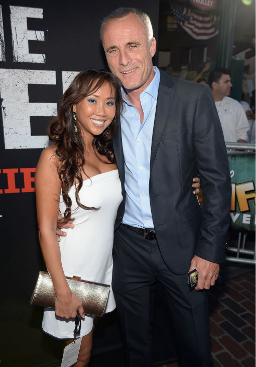 "<div class=""meta image-caption""><div class=""origin-logo origin-image ""><span></span></div><span class=""caption-text"">Cheryl Burke (L) of ABC's 'Dancing With The Stars' and cast members Timothy V. Murphy attend the world premiere of Disney/Jerry Bruckheimer Films' 'The Lone Ranger' at Disney California Adventure Park in Disneyland in Anaheim, California on June 22, 2013. (Michael Buckner / WireImage / Walt Disney Company)</span></div>"