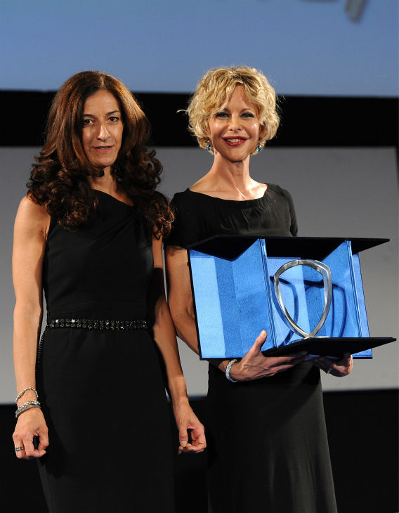 "<div class=""meta image-caption""><div class=""origin-logo origin-image ""><span></span></div><span class=""caption-text"">Meg Ryan, 51, receives the Taormina Arte Award Lancia  at the Taormina Filmfest 2013 in Taormina, Italy on June 20, 2013. Also pictured: Antonella Bruno. (Valerio Pennicino / Getty Images for Lancia)</span></div>"