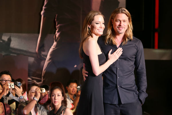 "<div class=""meta image-caption""><div class=""origin-logo origin-image ""><span></span></div><span class=""caption-text"">Angelina Jolie and partner and cast member Brad Pitt attend the 'World War Z' premiere at Roppongi Hills in Tokyo, Japan on July 29, 2013. (Ken Ishii / Getty Images for Paramount Pictures)</span></div>"