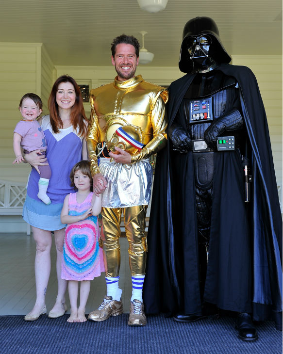 'How I Met Your Mother' star Alyson Hannigan, husband and fellow 'Buffy' alum Alexis Denisof and their daughters Satyana and Keeva (held by Hannigan) are seen at the Course Of The Force 2013, an 'Epic Lightsaber Relay,' benefiting the Make-A-Wish Foundati